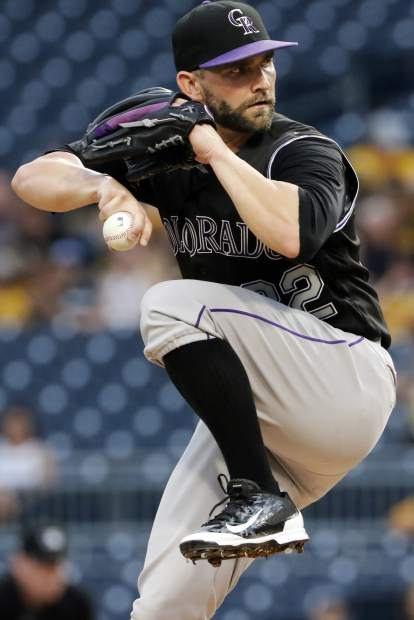 Colorado Rockies starting pitcher Tyler Chatwood delivers in the first inning of a baseball game against the Colorado Rockies in Pittsburgh, Tuesday, June 13, 2017. (AP Photo/Gene J. Puskar)