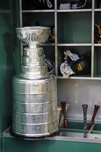 The Stanley Cup sits on the bat rack in the Pittsburgh Pirates dugout during a celebration of the Pittsburgh Penguins Stanley Cup win over the Nashville Predators before a baseball game between the Pittsburgh Pirates and the Colorado Rockies in Pittsburgh, Tuesday, June 13, 2017. (AP Photo/Gene J. Puskar)