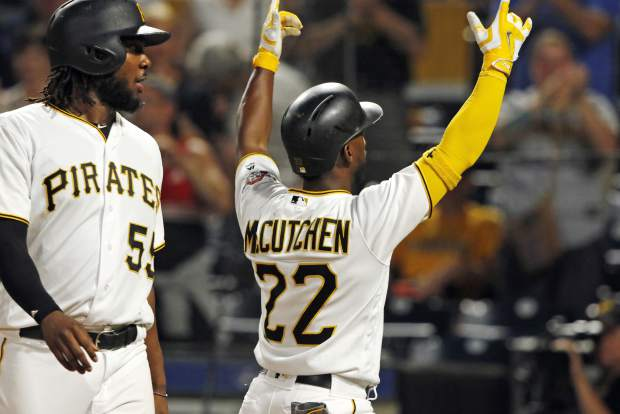 Pittsburgh Pirates' Andrew McCutchen (22) gestures to the crowd after hitting a two-run home run off Colorado Rockies relief pitcher Jordan Lyles in the eighth inning of a baseball game in Pittsburgh, Tuesday, June 13, 2017. It was McCutchen's second homer of the game. The Pirates won 5-2. (AP Photo/Gene J. Puskar)