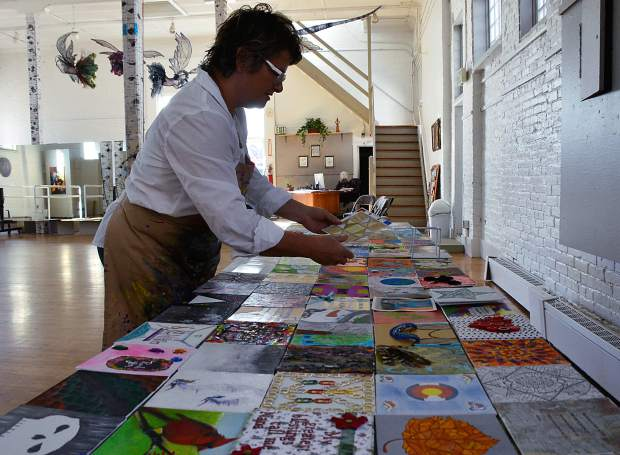 Terry Muldoon lays out canvases for the Glenwood Springs Center for the Arts annual 6x6 exhibit.
