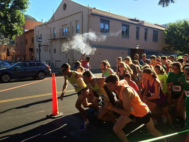 Runners take off at the sound of the starting gun for the Strawberry Shortcut 5K Sunday morning.
