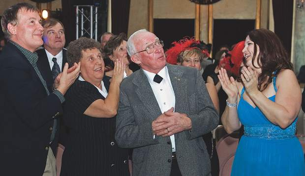 Friends and family, including his wife, Judy, applaud Bill Slattery after he was named the Glenwood Springs Resort Association's Citizen of the Year for 2007.