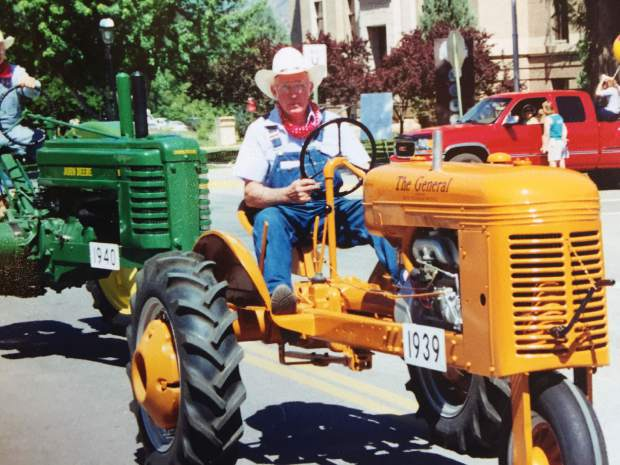 Bill Slattery drives his prized 1939 Avery General tractor in a past Strawberry Days Parade.