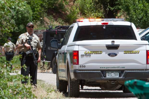 Armed officers staked out a Canyon Creek home after a wanted man slipped inside in the morning when authorities tried to serve warrants.