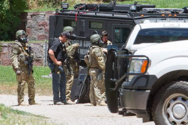 Garfield County law enforcement as well as the All Hazards Response Team work to coax a man out of his home after he barricaded himself inside after officers attempted to serve him with multiple arrest warrants.