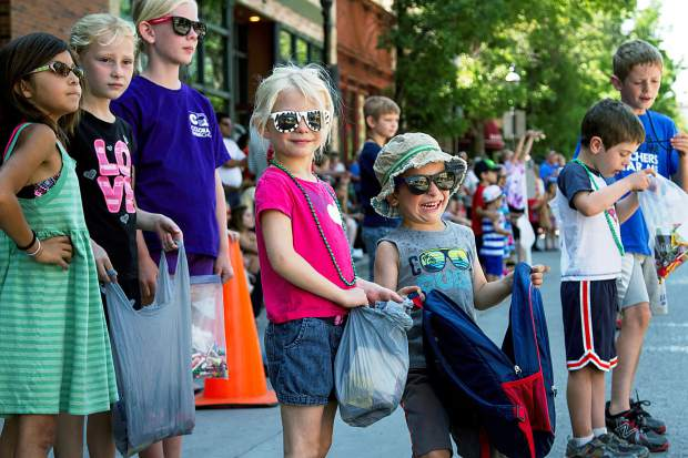 Excited kids wait anxiously to collect as much candy as possible during the 2015 Strawberry Days Parade.