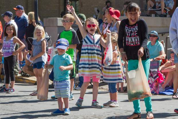 Excited kids rush to collect as much candy as possible during the 2017 Strawberry Days parade.