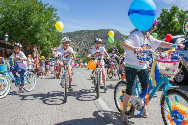 Sunlight Bike and Ski representatives make their way down Grand Avenue for the 2017 Strawberry Days parade on Saturday morning.