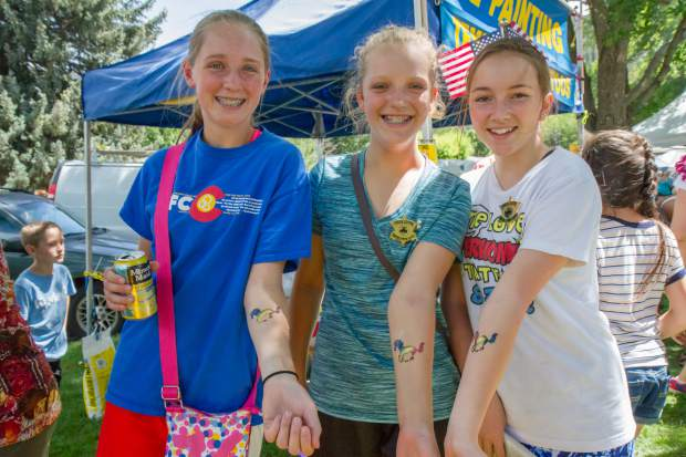 Friends Kenna Wilson, Gracie Stewart and Lindsay Juhl show off their matching tattoos in the park after the 2017 Strawberry Days Parade. All three girls were born and raised in Glenwood and enjoy the festival every year.