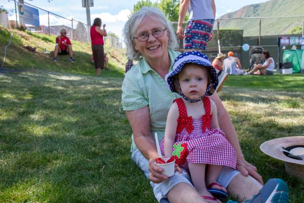 Two-year-old Piper Dykema and her grandmother Joanie enjoy the free strawberries and ice cream in the park after the parade Saturday morning. Piper's parents were born and raised in Glenwood Springs but currently live in Fort Collins and travel to Glenwood every year for Strawberry Days.