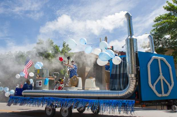 The Bishop Plumbing and Heating float makes its way down Grand Avnue for the 2017 Strawberry Days parade on Saturday morning.