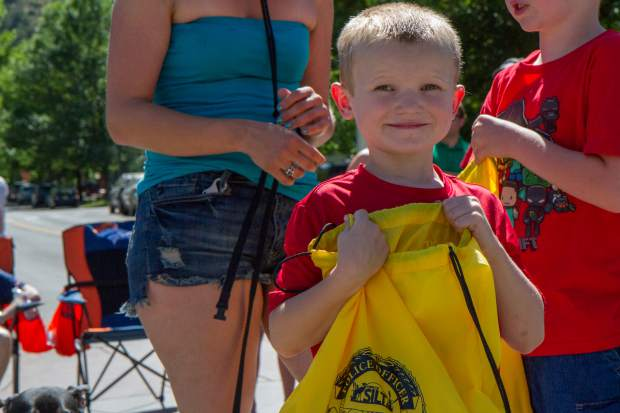 Five-year-old Evan Miller enjoys his first time at parade with his brother James.