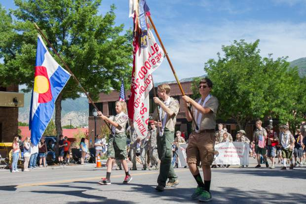 Local Boy Scout troop 225 lead the procession of the 2017 Strawberry Days Parade on Grand Avenue on Saturday monring.