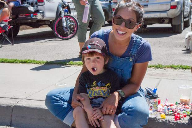 AnaClarissa Norris and her son Harrison watch the 2017 Strawberry Days parade for the first time on Saturday morning.