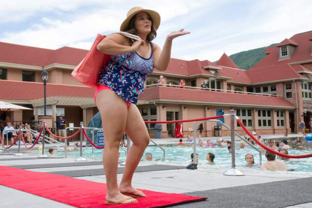 Madison Starbuck sends a kiss smiles into the crowd at the end of the runway during the 2017 Miss Strawberry Days Fashion Show at the Glenwood Hot Springs Pool.
