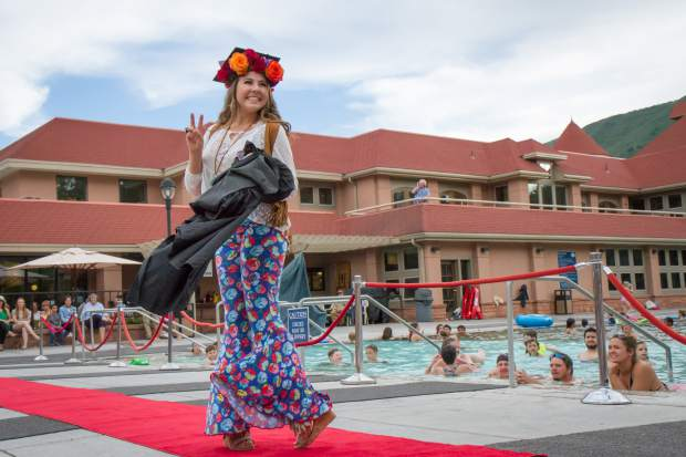 Miss Strawberry Days contestant Savana Miller Otto send peace into the crowd during the 2017 Miss Strawberry Days Fashion Show at the Glenwood Hot Springs Pool.