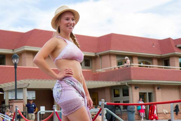 Chandler Hagemann smiles for the crowd at the end of the runway during the 2017 Miss Strawberry Days Fashion Show at the Glenwood Hot Springs Pool.