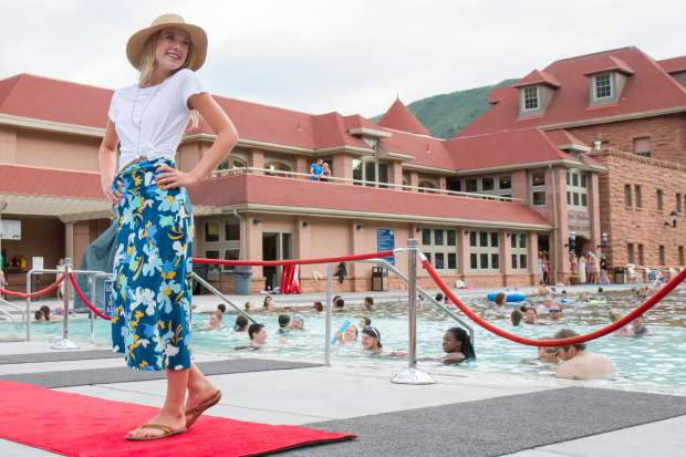 Hannah Young smiles for the crowd at the end of the runway during the 2017 Miss Strawberry Days Fashion Show at the Glenwood Hot Springs Pool.