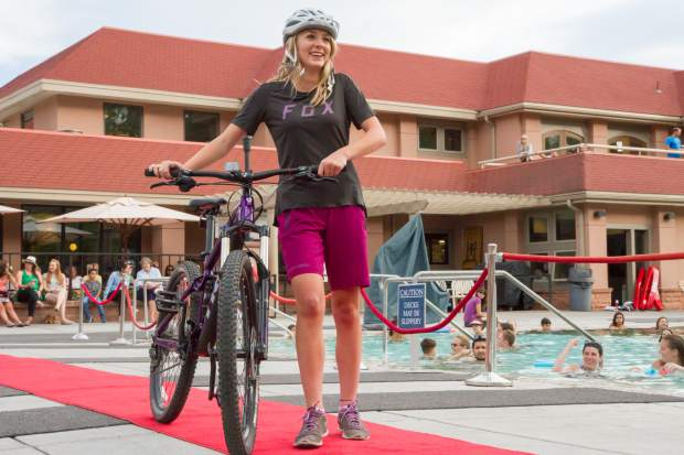 Miss Strawberry Days contestant Carly Shimp represents Summit Canyon Mountaineering during the 2017 Miss Strawberry Days Fashion Show at the Glenwood Hot Springs Pool.