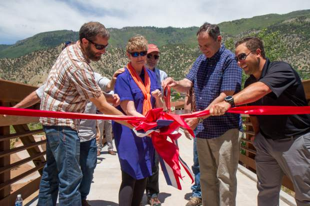 Members of Glenwood Springs City Council and other representatives cut the ribbon officially opening the new West Midland Trail and foot bridge. The new foot and bicycle path that's viewed as an important alternative transportation route between West Glenwood and Glenwood Meadows and on to downtown, especially during the upcoming Grand Avenue bridge detour, is now ready for folks to give it a try.