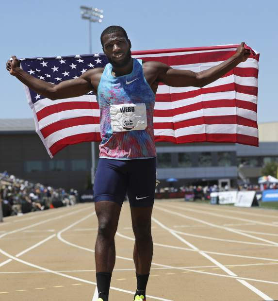 Ameer Webb holds a United States flag after he won the men's 200 meters at the U.S. Track and Field Championships, Sunday, June 25, 2017, in Sacramento, Calif. (AP Photo/Rich Pedroncelli)