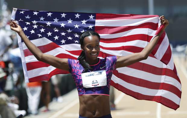 Dalilah Muhammad holds up the U.S. flag after she won the women's 400-meter hurdles at the U.S. Track and Field Championships, Sunday, June 25, 2017, in Sacramento, Calif. (AP Photo/Rich Pedroncelli)