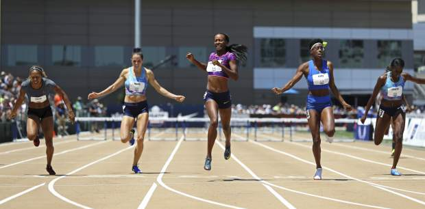 Dalilah Muhammad, center, wins the women's 400-meter hurdles at the U.S. Track and Field Championships, Sunday, June 25, 2017, in Sacramento, Calif. Shamier Little, second from right, finished second, and Kori Carter, left, finished third. (AP Photo/Rich Pedroncelli)