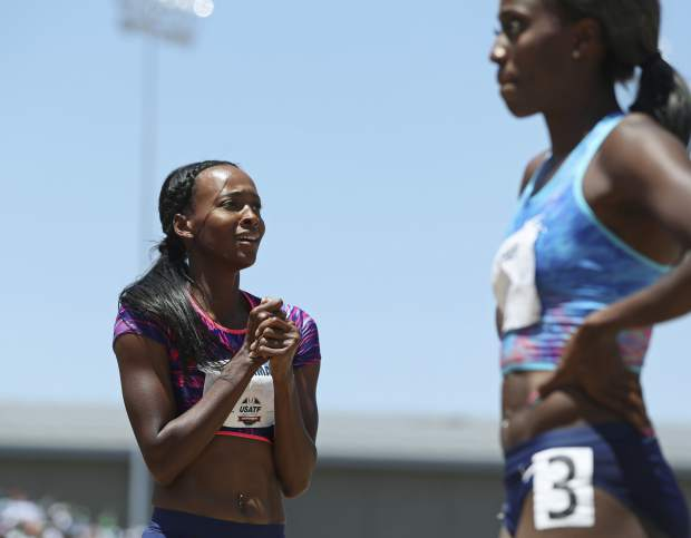 Dalilah Muhammad, left, reacts at the finish line after she won the women's 400-meter hurdles at the U.S. Track and Field Championships, Sunday, June 25, 2017, in Sacramento, Calif. Ashley Spencer, right, finished fourth. (AP Photo/Rich Pedroncelli)