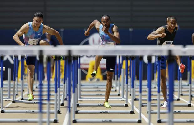From left, Devon Allen, Aries Merritt, and Aleec Harris run the men's 110-meter hurdles at the U.S. Track and Field Championships, Sunday, June 25, 2017, in Sacramento, Calif. Harris won the event, Merritt finished second, and Allen finished third. (AP Photo/Rich Pedroncelli)