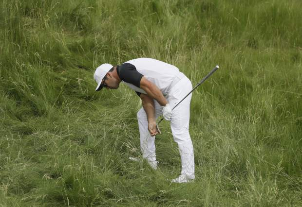 Paul Casey looks at his ball in the fescue on the 14th hole during the second round of the U.S. Open golf tournament Friday.