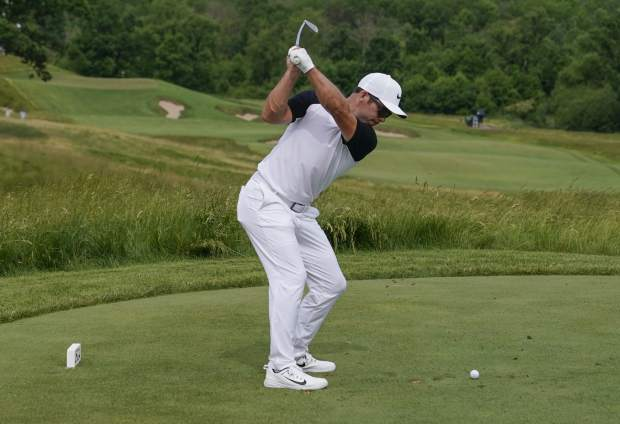Paul Casey, of England, hits from the 15th tee during the second round of the U.S. Open golf tournament Friday, June 16, 2017, at Erin Hills in Erin, Wis. (AP Photo/David J. Phillip)