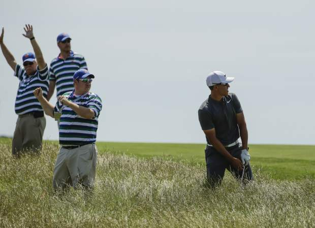 Cameron Champ looks to hit out of the fescue on the seventh hole during the second round of the U.S. Open golf tournament Friday, June 16, 2017, at Erin Hills in Erin, Wis. (AP Photo/Charlie Riedel)