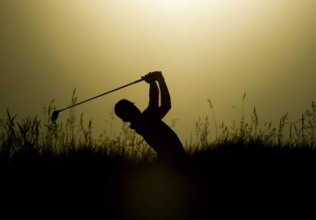 Xander Schauffele hits a drive on the eighth hole during the first round of the U.S. Open golf tournament Thursday, June 15, 2017, at Erin Hills in Erin, Wis. (AP Photo/Charlie Riedel)