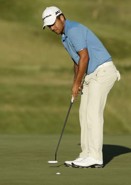 Xander Schauffele makes a putt on the seventh hole during the first round of the U.S. Open golf tournament Thursday, June 15, 2017, at Erin Hills in Erin, Wis. (AP Photo/Charlie Riedel)