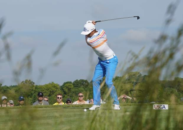 Rickie Fowler hits from the 13th tee during the first round of the U.S. Open golf tournament Thursday, June 15, 2017, at Erin Hills in Erin, Wis. (AP Photo/David J. Phillip)