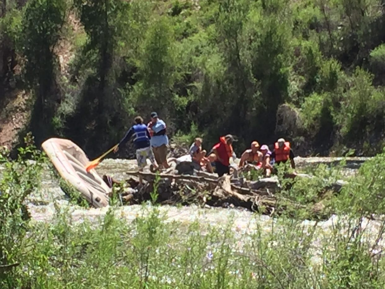 A group of boaters stuck in a logjam Monday afternoon at Roaring Fork River.