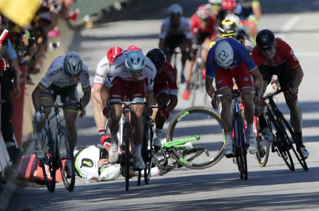 Britain's Mark Cavendish crashes during the sprint of the fourth stage of the Tour de France on Tuesday.