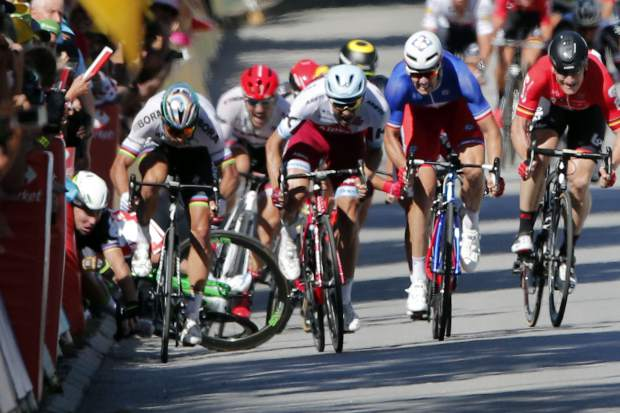 Peter Sagan of Slovakia, left, sprints as Britain's Mark Cavendish crashes during the sprint of the fourth stage of the Tour de France cycling race over 207.5 kilometers (129 miles) with start in Mondorf-les-Bains, Luxembourg, and finish in Vittel, France, , Tuesday, July 4, 2017. (AP Photo/Christophe Ena)