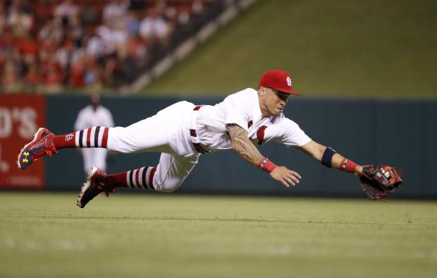 St. Louis Cardinals second baseman Kolten Wong dives to stop a single by Colorado Rockies' Carlos Gonzalez during the seventh inning of a baseball game Monday, July 24, 2017, in St. Louis. (AP Photo/Jeff Roberson)