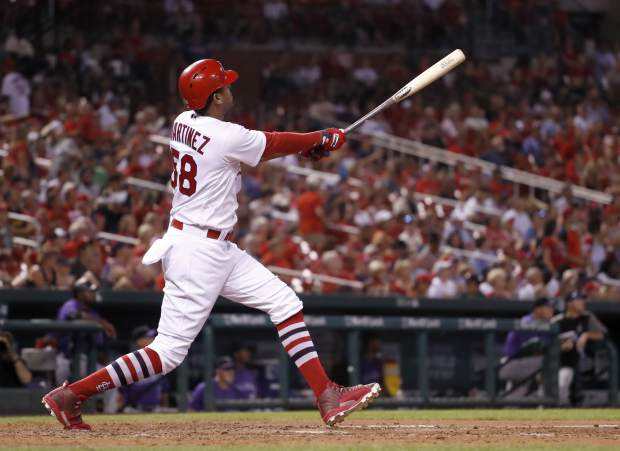 St. Louis Cardinals' Jose Martinez watches his solo home run during the seventh inning of a baseball game against the Colorado Rockies, Monday, July 24, 2017, in St. Louis. (AP Photo/Jeff Roberson)