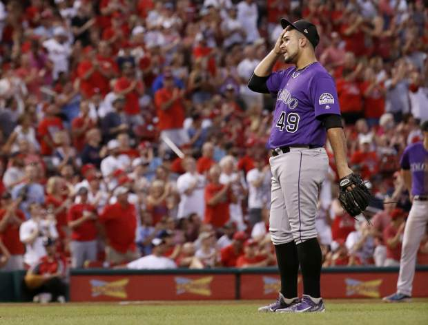 Colorado Rockies starting pitcher Antonio Senzatela pauses after giving up a two-run home run to St. Louis Cardinals' Randal Grichuk during the fourth inning of a baseball game Monday, July 24, 2017, in St. Louis. (AP Photo/Jeff Roberson)