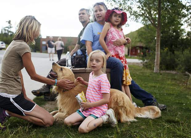 Paige Ratliff, 7, in front, and the evacuees watch from Summit Middle School as the fire continues near their homes close to Peak 2 Wednesday, July 5, in Frisco.