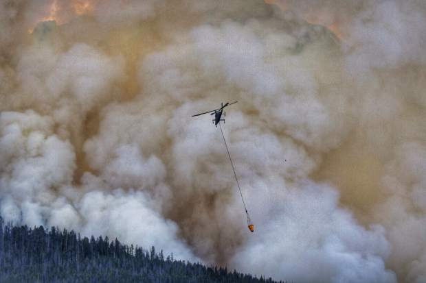 A helicopter dumps water on to the Peak 2 Fire near Breckenridge on Wednesday, July 5.