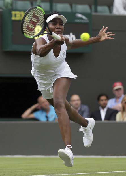 Venus Williams of the United States returns to Belgium's Elise Mertens during their Women's Singles Match on the opening day at the Wimbledon Tennis Championships in London Monday, July 3, 2017. (AP Photo/Tim Ireland)