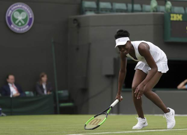 Venus Williams of the United States smiles during her Women's Singles Match against Belgium's Elise Mertens on the opening day at the Wimbledon Tennis Championships in London Monday, July 3, 2017. (AP Photo/Tim Ireland)