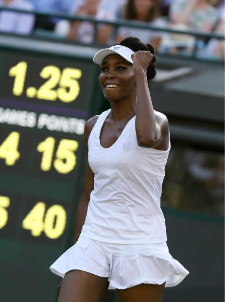 Venus Williams of the United States celebrates winning against Japan's Naomi Osaka in their Women's Singles Match on day five at the Wimbledon Tennis Championships in London Friday, July 7, 2017. (AP Photo/Kirsty Wigglesworth)