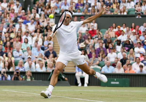 Switzerland's Roger Federer returns to Germany's Mischa Zverev during their Men's Singles Match on day six at the Wimbledon Tennis Championships in London Saturday, July 8, 2017. (AP Photo/Tim Ireland)