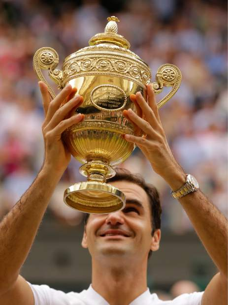 Switzerland's Roger Federer holds the trophy after beating Croatia's Marin Cilic in the Men's Singles final match on day thirteen at the Wimbledon Tennis Championships in London Sunday, July 16, 2017. (AP Photo/Alastair Grant)