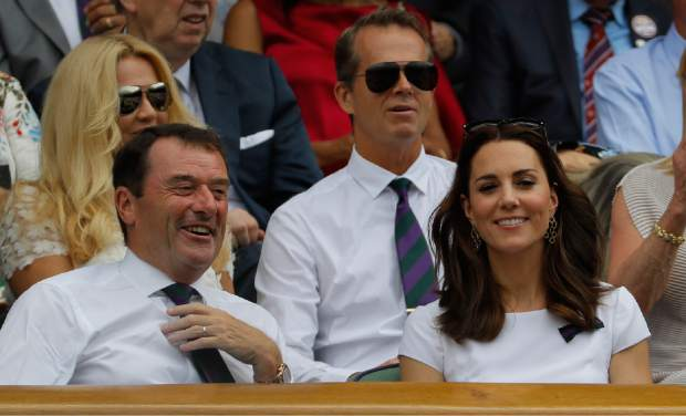 Kate, the Duchess of Cambridge next to Philip Brook, Chairman of the All England Lawn Tennis Club, and in front of former Swedish tennis player Stefan Edberg in the Royal Box ahead of the Men's Singles final match between Switzerland's Roger Federer and Croatia's Marin Cilic on day thirteen at the Wimbledon Tennis Championships in London Sunday, July 16, 2017. (AP Photo/Alastair Grant)