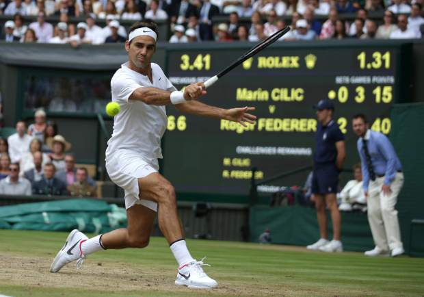 Switzerland's Roger Federer returns to Croatia's Marin Cilic during the Men's Singles final match on day thirteen at the Wimbledon Tennis Championships in London Sunday, July 16, 2017. (Daniel Leal-Olivas/Pool Photo via AP)